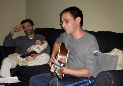 Jona plays the guitar for his family.